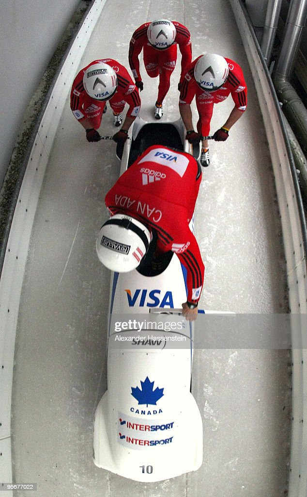 Team Canada 2 with pilot <a gi-track='captionPersonalityLinkClicked' href=/galleries/search?phrase=Pierre+Lueders&family=editorial&specificpeople=211058 ng-click='$event.stopPropagation()'>Pierre Lueders</a> and his team mates Justin Kripps, Jesse Lumsden and Neville Wright start at the final run of the four men's Bobsleigh World Cup event on January 10, 2010 in Koenigssee, Germany.