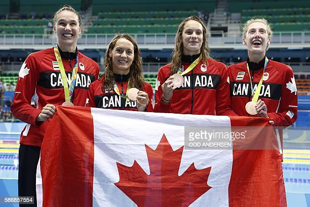Team Canada Canada's Sandrine Mainville Canada's Chantal van Landeghem Canada's Taylor Ruck and Canada's Penny Oleksiak pose with their bronze medals...
