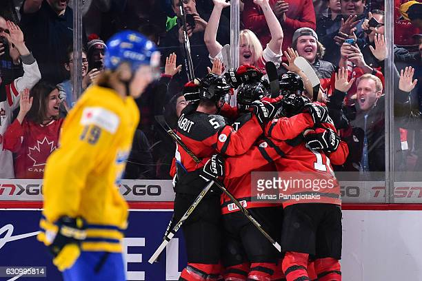 Team Canada celebrate a goal in the third period during the 2017 IIHF World Junior Championship semifinal game against Team Sweden at the Bell Centre...