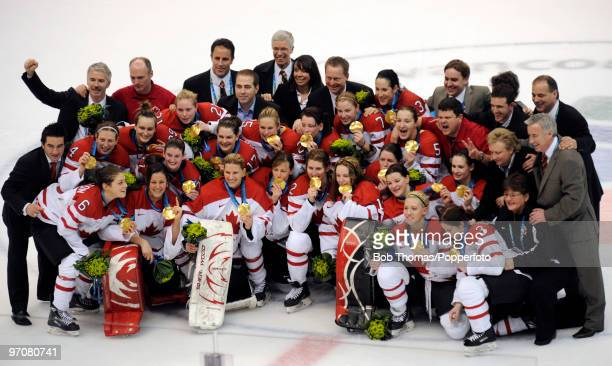 Team Canada celebrate winning the gold medal following their 20 victory during the ice hockey women's gold medal game between Canada and USA on day...