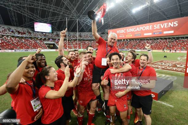 Team Canada celebrates after defeating USA in the Cup Final 2017 Singapore Sevens match at National Stadium on April 16 2017 in Singapore