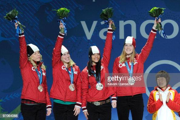 Team Canada celebrates receiving the silver medal during the medal ceremony for the ladies' 3000 m relay short track on day 14 of the Vancouver 2010...