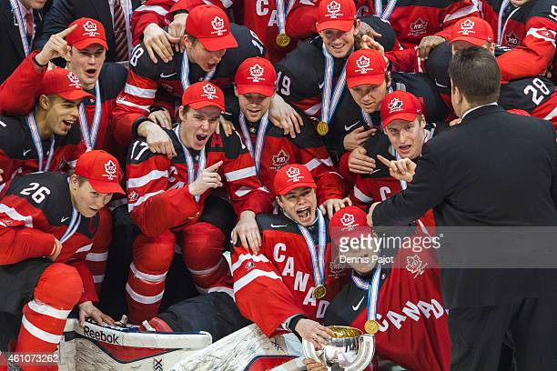 Team Canada celebrates the 54 win over Russia during the Gold medal game of the 2015 IIHF World Junior Championship on January 05 2015 at the Air...