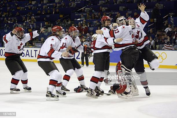 Team Canada celebrates winning 32 over the USA in the women's ice hockey gold medal game at the Salt Lake City Winter Olympic at the E Center in Salt...