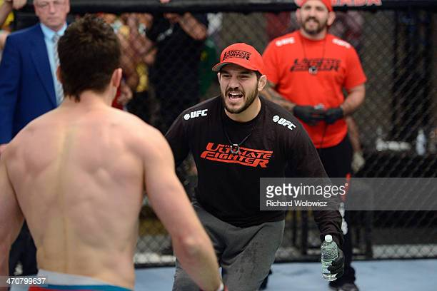 Team Canada coach Patrick Cote cheers on his fighter Sheldon Westcott after submitting Team Australia fighter Daniel Kelly in their middleweight...
