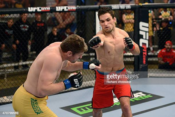 Team Canada fighter Sheldon Westcott punches Team Australia fighter Daniel Kelly in their middleweight fight during filming of The Ultimate Fighter...