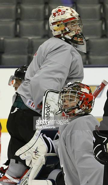 TORONTO JANUARY 3 Team Canada goaltenders Eric Comrie and Zachary Fucale pass one another during the morning skate Team Canada practice at the Air...