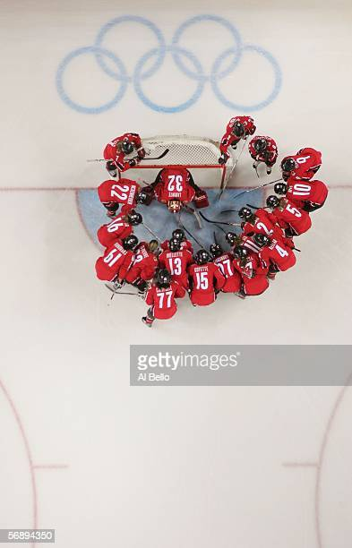 Team Canada huddles around their goal before taking on Sweden during the final of the women's ice hockey during Day 10 of the Turin 2006 Winter...