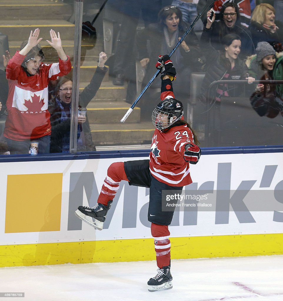 TORONTO, ON - DECEMBER 30 - Team Canada Natalie Spooner (24) celebrates her second period goal against Team United States during exhibition Women's Hockey at the Air Canada Centre, December 30, 2013.