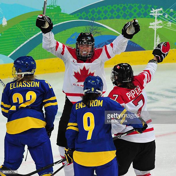 Team canada players Gillian Apps and Cherie Piper celebrate a goal during the Women's Ice Hockey preliminary game between Canada and Sweden at the...