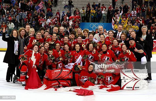 Team Canada pose for a picture after they won the gold medal in women's ice hockey match against Sweden during Day 10 of the Turin 2006 Winter...