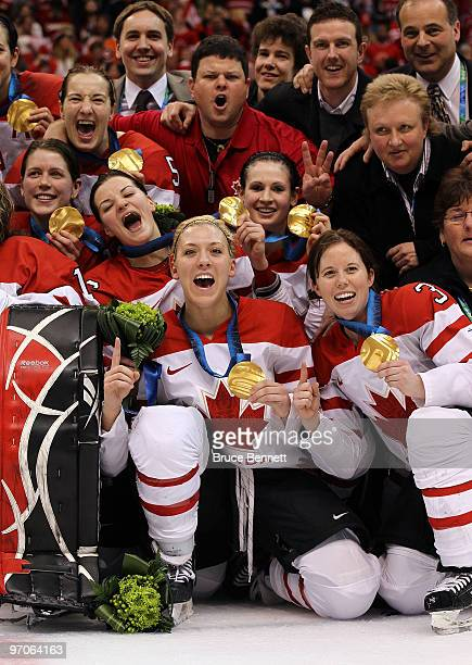 Team Canada pose with the gold medals following their 20 victory during the ice hockey women's gold medal game between Canada and USA on day 14 of...