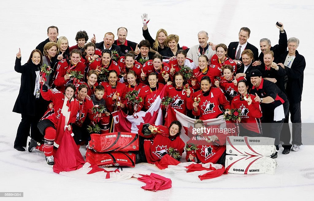 Team Canada poses after receiving the gold medal following their 41 victory over Sweden in women's ice hockey during Day 10 of the Turin 2006 Winter...