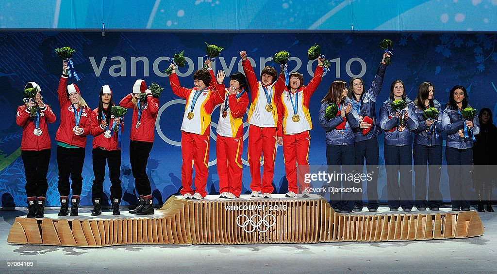 Team Canada receives the silver medal, Team China receives the gold medal and Team USA receives the bronze medal during the medal ceremony for the ladies' 3000 m relay short track on day 14 of the Vancouver 2010 Winter Olympics at BC Place on February 25, 2010 in Vancouver, Canada.