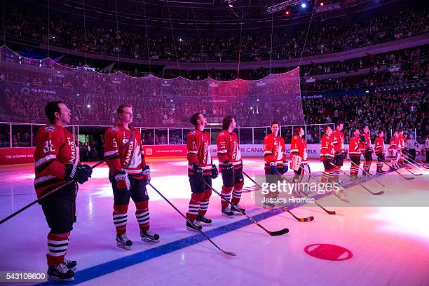 Team Canada stand for the national anthem before the Wayne Gretzky Ice Hockey Classic between Team USA and Team Canada at Qudos Bank Arena on June 25...