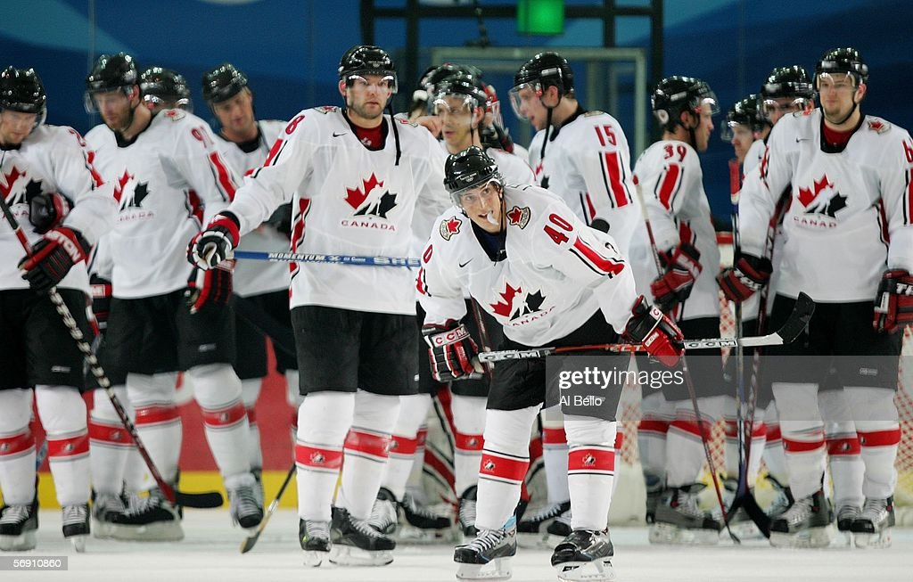 Team Canada stands dejected after falling to Russia 20 in their quarter final of the men's ice hockey match during Day 12 of the Turin 2006 Winter...