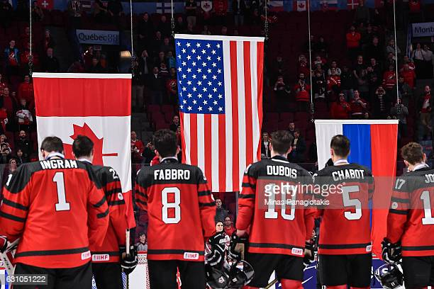 Team Canada watches as the flags of Canada United States and Russia are being raised during the 2017 IIHF World Junior Championship gold medal game...