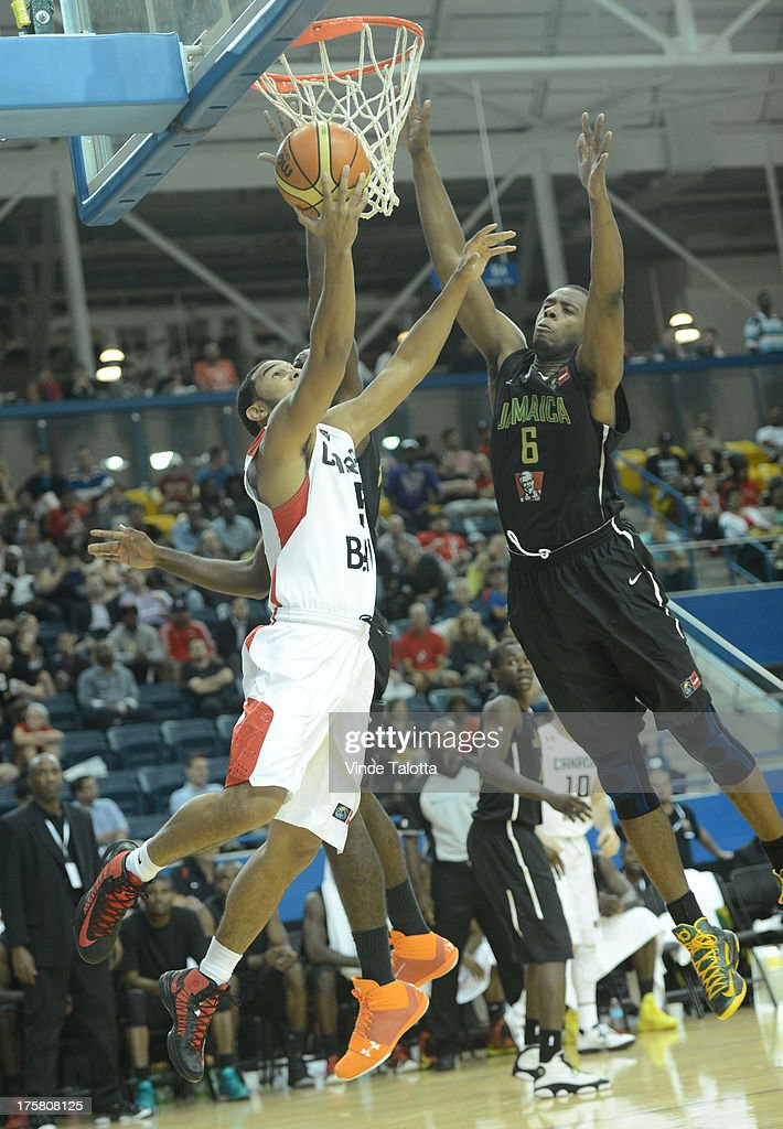 TORONTO, ON - AUGUST 8 - Team Canada's Cory Joseph goes to against Team Jamaica's Patrick Ewing Junior during the first half at the 2013 Jack Donahue International Classic at the Mattamy Athletic Centre in Toronto on August 8, 2013