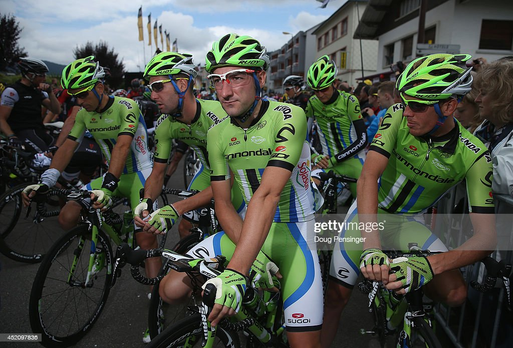 Team Cannondale riders Marco Marcato of Italy, <a gi-track='captionPersonalityLinkClicked' href=/galleries/search?phrase=Fabio+Sabatini&family=editorial&specificpeople=4462976 ng-click='$event.stopPropagation()'>Fabio Sabatini</a> of Italy, <a gi-track='captionPersonalityLinkClicked' href=/galleries/search?phrase=Elia+Viviani&family=editorial&specificpeople=5708574 ng-click='$event.stopPropagation()'>Elia Viviani</a> of Italy, Ted King of the United States and <a gi-track='captionPersonalityLinkClicked' href=/galleries/search?phrase=Alessandro+De+Marchi&family=editorial&specificpeople=5708572 ng-click='$event.stopPropagation()'>Alessandro De Marchi</a> of Italy and Cannondale prepare for the start of stage nine as they work to help defend the points leader's jersey for teammate Peter Sagan of Slovakia and Cannondale in the 2014 Le Tour de France from Gerardmer to Mulhouse on July 13, 2014 in Gerardmer, France.