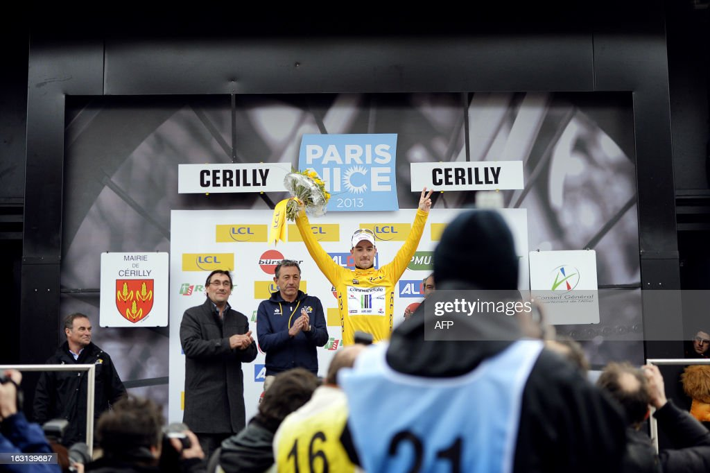 Team Cannondale's Italian cyclist Elia Viviani (C) celebrates with his overall leader's yellow jersey on the podium after the second stage of the 71st Paris-Nice cycling race, between Vimory and Cerilly, on March 5, 2013. AFP PHOTO / JEFF PACHOUD