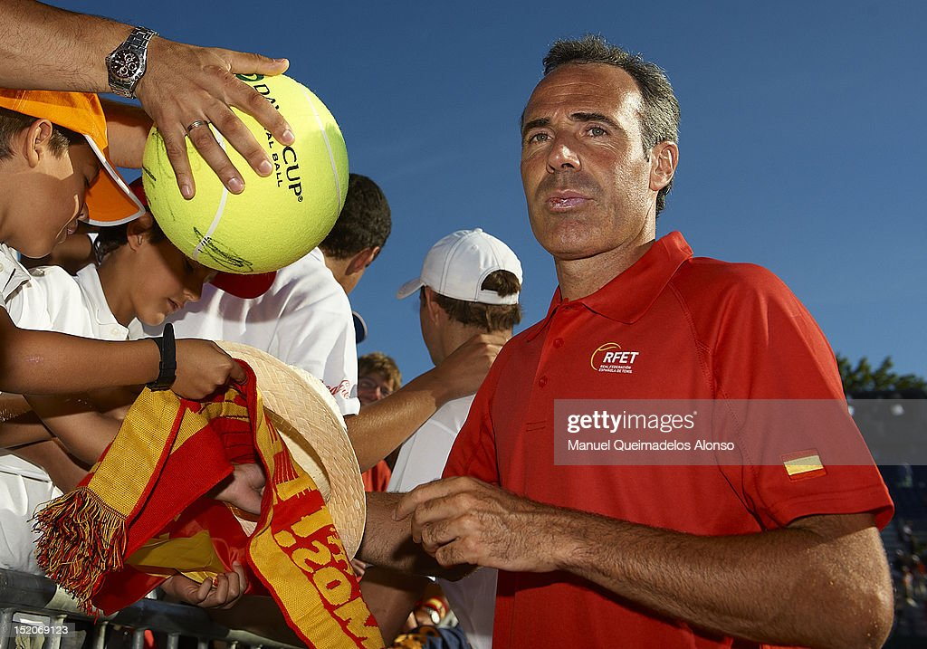 Team captain <a gi-track='captionPersonalityLinkClicked' href=/galleries/search?phrase=Alex+Corretja&family=editorial&specificpeople=211620 ng-click='$event.stopPropagation()'>Alex Corretja</a> of Spain signs autographs for fans after day two of the semi final Davis Cup between Spain and the United States at the Parque Hermanos Castro on September 15, 2012 in Gijon, Spain.