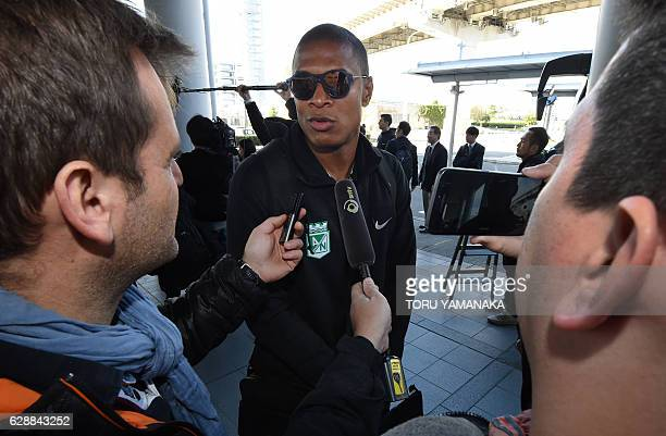 Team captain Alexis Charales of Colombian football club Atletico Nacional answers questions upon their arrival at Kansai Airport in Izumisano Osaka...