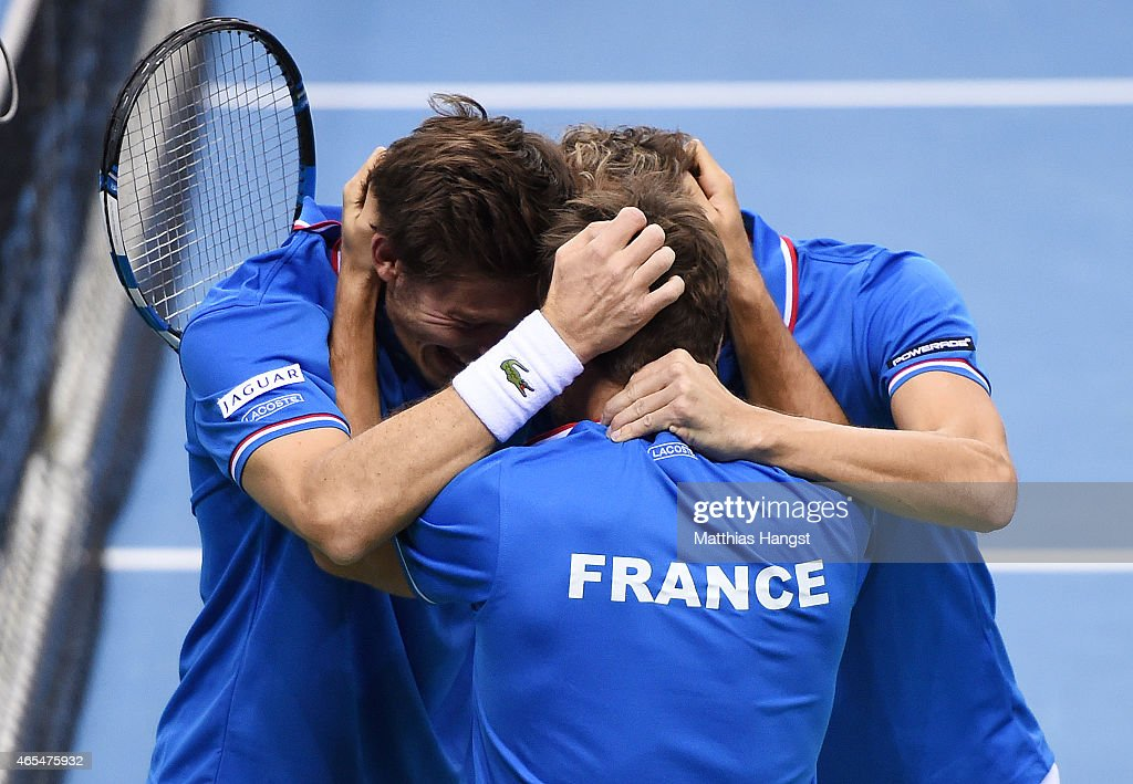 Team captain <a gi-track='captionPersonalityLinkClicked' href=/galleries/search?phrase=Arnaud+Clement&family=editorial&specificpeople=203192 ng-click='$event.stopPropagation()'>Arnaud Clement</a> of France celebrates with <a gi-track='captionPersonalityLinkClicked' href=/galleries/search?phrase=Julien+Benneteau&family=editorial&specificpeople=228097 ng-click='$event.stopPropagation()'>Julien Benneteau</a> and <a gi-track='captionPersonalityLinkClicked' href=/galleries/search?phrase=Nicolas+Mahut&family=editorial&specificpeople=547869 ng-click='$event.stopPropagation()'>Nicolas Mahut</a> of France after winning their match against Benjamin Becker and Andre Begemann of Germany in their doubles match during day two of the Davis Cup World Group first round between Germany and France at Fraport Arena on March 7, 2015 in Frankfurt am Main, Germany.