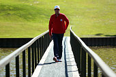 USA team captain Davis Love III of the United States crosses a bridge during the Singles Matches for The 39th Ryder Cup at Medinah Country Club on...