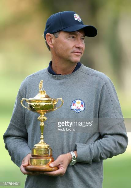 Team captain Davis Love III poses for an official photograph with the Ryder Cup during the second preview day of The 39th Ryder Cup at Medinah...