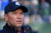 Team captain Davis Love III waits on the first tee during day two of the Morning Foursome Matches for The 39th Ryder Cup at Medinah Country Club on...