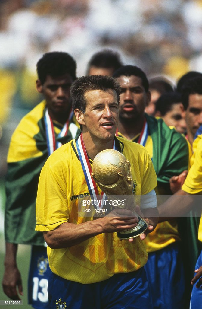 Team captain Dunga holding the FIFA World Cup Trophy after Brazil beat Italy 32 on penalties in the final of the World Cup at the Rose Bowl Pasadena...