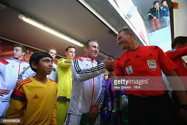 Team captain Felix Passlack of Germany shakes hands with the assistant referee in the tunnel prior to the FIFA U17 World Cup Chile 2015 Round of 16...