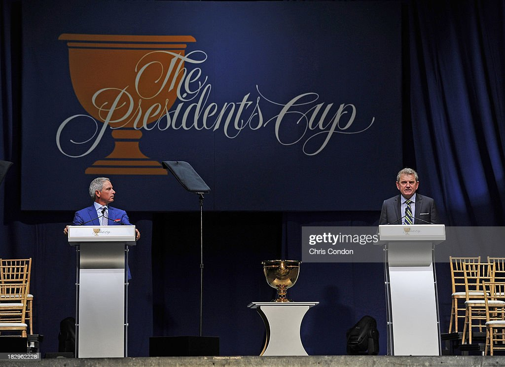 U.S. team captain Fred Couples and International team captain Nick Price of Zimbabwe speak during the opening ceremonies at Columbus Commons prior to the start of The Presidents Cup at Muirfield Village Golf Club on October 2, 2013 in Dublin, Ohio.