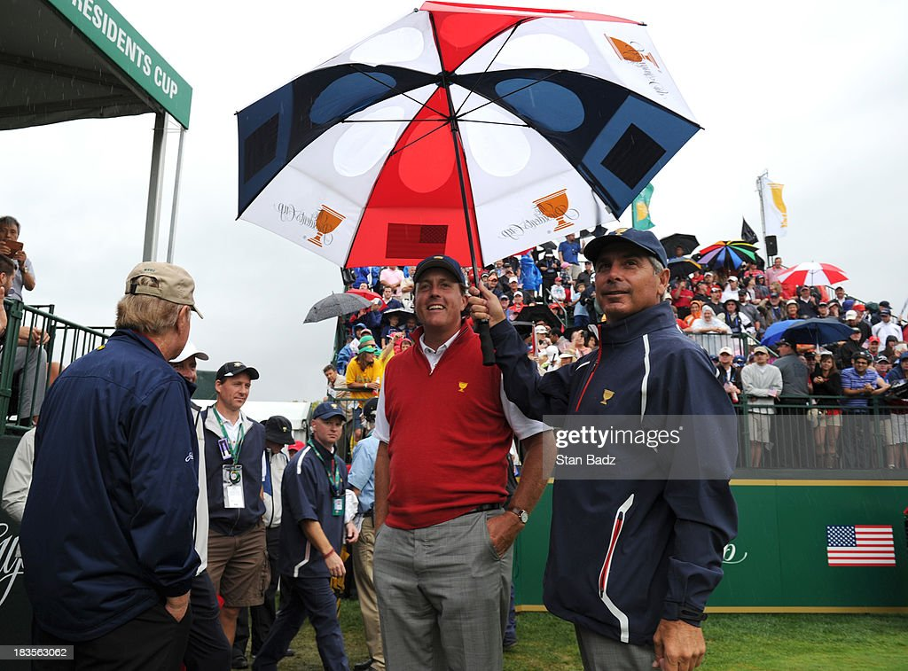 U.S. Team captain Fred Couples and Phil Mickelson of the U.S. Team wait on the first hole during the Final Round Singles Matches of The Presidents Cup at the Muirfield Village Golf Club on October 6, 2013 in Dublin, Ohio.