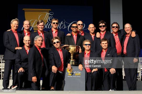 S Team captain Fred Couples poses with his team and the Presidents Cup during the closing ceremonies after defeating the International team 1915 at...