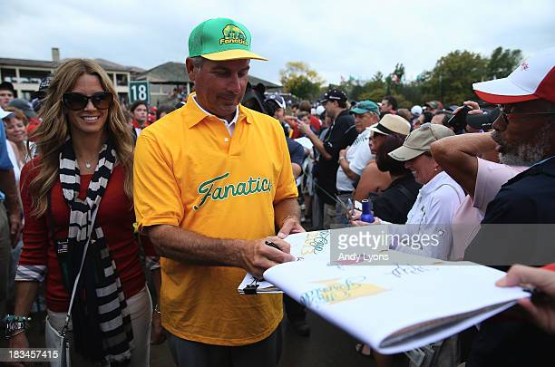 S Team Captain Fred Couples signs autographs after the US Team defeated the International Team 185 to 155 after the Day Four Singles Matches at the...