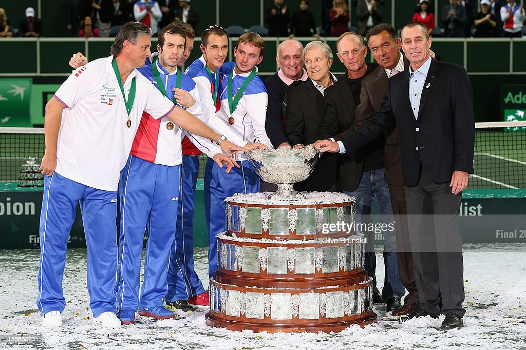 L-R Team captain Jaroslav Navratil, <a gi-track='captionPersonalityLinkClicked' href=/galleries/search?phrase=Radek+Stepanek&family=editorial&specificpeople=193842 ng-click='$event.stopPropagation()'>Radek Stepanek</a>,<a gi-track='captionPersonalityLinkClicked' href=/galleries/search?phrase=Tomas+Berdych&family=editorial&specificpeople=239147 ng-click='$event.stopPropagation()'>Tomas Berdych</a>, <a gi-track='captionPersonalityLinkClicked' href=/galleries/search?phrase=Lukas+Rosol&family=editorial&specificpeople=4100845 ng-click='$event.stopPropagation()'>Lukas Rosol</a>,<a gi-track='captionPersonalityLinkClicked' href=/galleries/search?phrase=Ivo+Minar&family=editorial&specificpeople=193821 ng-click='$event.stopPropagation()'>Ivo Minar</a> of Czech Republic and 1980 winning team Pavel Korda team captain,Jan Kodes,Pavel Slozil, Tomas Smid and <a gi-track='captionPersonalityLinkClicked' href=/galleries/search?phrase=Ivan+Lendl&family=editorial&specificpeople=242990 ng-click='$event.stopPropagation()'>Ivan Lendl</a> pose by the winners trophy after a 3-2 victory against Spain during day three of the final Davis Cup match between Czech Republic and Spain at the 02 Arena on November 18, 2012 in Prague, Czech Republic.