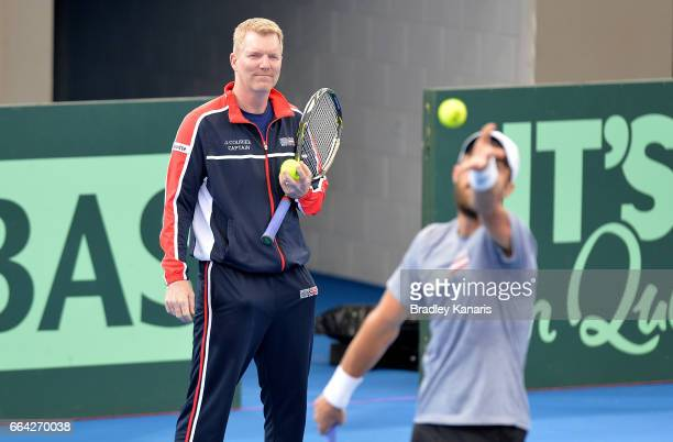 Team Captain Jim Courier of the USA watches on as Steve Johnson serves during a practice session ahead of the Davis Cup World Group Quarterfinals tie...
