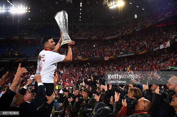 Team captain Jose Antonio Reyes of Sevilla FC poses for photographers with the trophy after the UEFA Europa League Final matach between Liverpool and...