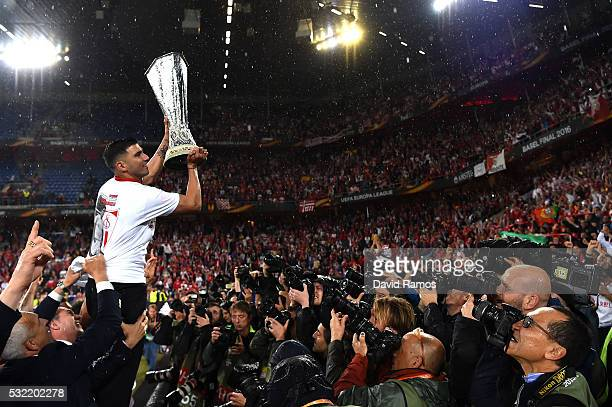 Team captain Jose Antonio Reyes of Sevilla poses for photograhs with the trophy after the UEFA Europa League Final match between Liverpool and...