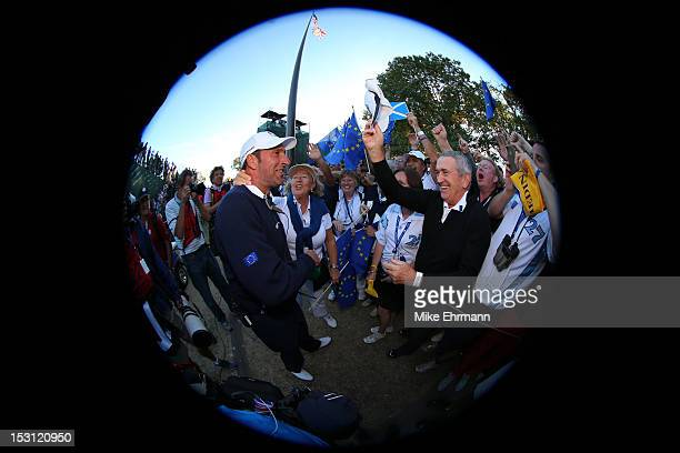 Team captain Jose Maria Olazabal celebrates with fans after Europe defeated the USA 145 to 135 to retain the Ryder Cup during the Singles Matches for...
