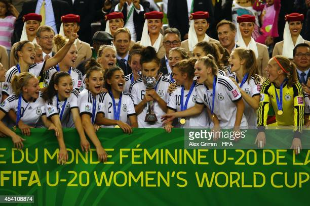 Team captain Lina Magull lifts the World Cup trophy and celebrates with team mates after winning the FIFA U20 Women's World Cup Canada 2014 final...
