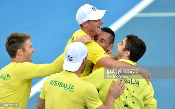 Team Captain Lleyton Hewitt of Australia celebrates victory with his team of Nick Kyrgios Sam Groth Jordan Thompson and Joh Peers after the match...