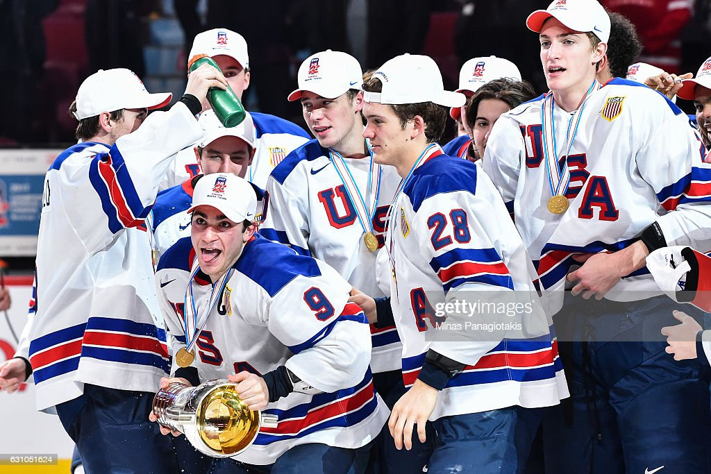 Team captain Luke Kunin #9 of Team United States skates off with the IIHF trophy during the 2017 IIHF World Junior Championship gold medal game against Team Canada at the Bell Centre on January 5, 2017 in Montreal, Quebec, Canada. Team United States defeats Team Canada 5-4 in a shootout and wins the gold medal round.