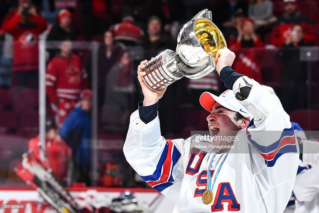 Team captain Luke Kunin #9 of Team United States skates off with the IIHF trophy during the 2017 IIHF World Junior Championship gold medal game against Team Canada at the Bell Centre on January 5, 2017 in Montreal, Quebec, Canada. Team United States defeated Team Canada 5-4 in a shootout and won the gold medal round.