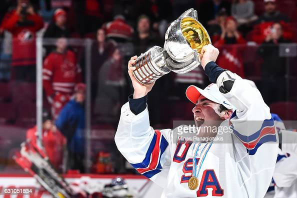Team captain Luke Kunin of Team United States skates off with the IIHF trophy during the 2017 IIHF World Junior Championship gold medal game against...