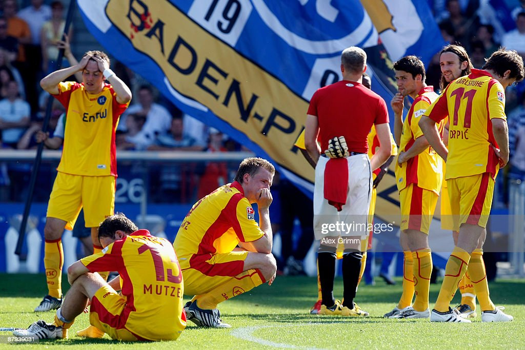 Team captain Maik Franz of Karlsruhe and team mates mourn after the Bundesliga match between Karlsruher SC and Hertha BSC Berlin at Wildpark Stadium...