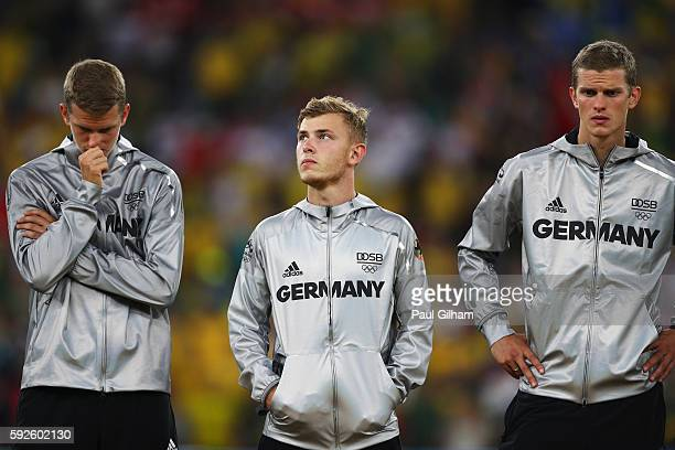 Team captain Maximilian Meyer and German team mates look despondent after their defeat during the Men's Football Final between Brazil and Germany at...