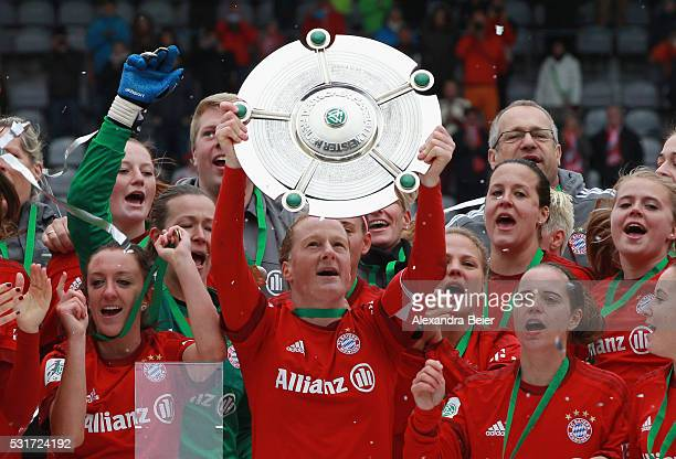 Team captain Melanie Behringer and her teammates of Bayern Muenchen celebrate the German Championship victory after the women Bundesliga match...