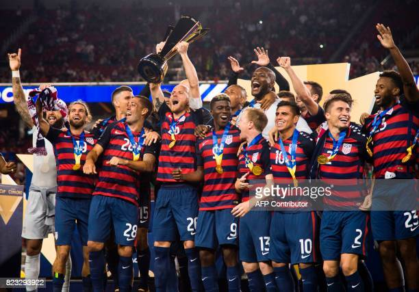 USA team captain Michael Bradley holds up the trophy as he celebrates with teammates after USA defeated Jamaica 21 in the 2017 CONCACAF Final July 26...